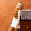 Blond vintage 70s kid girl with retro wood tv — Stock Photo #16099861