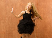 Black dress kid girl dancing and twisting vintage — Stock Photo
