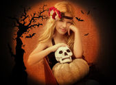 Halloween kid girl with pumpkin and skull smiling — Stock Photo