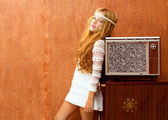 Blond vintage 70s kid girl with retro wood tv — Stock Photo