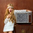 Royalty-Free Stock Photo: Blond vintage 70s kid girl with retro wood tv surprised