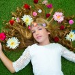 Stock Photo: Blond spring girl with flowers on hair over grass