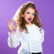 Children fashion scaring makeup kid girl on purple — Stock Photo