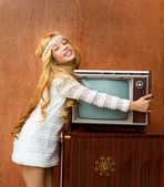 Blond vintage 70s kid girl with retro love old tv — Stock Photo