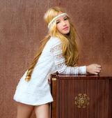 Blond children girl retro 70s with vintage furniture — Stock Photo