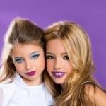 Two friends fashiondoll kid girls with fashion purple makeup — Stock Photo #16114591