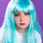 Children girl with blue truquoise long wig as fashiondoll — Stock Photo