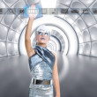 Stock Photo: Futuristic kid girl in silver touching finger icons