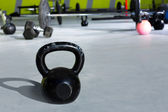Kettlebell at crossfit gym with lifting bars — Stock Photo