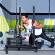 Crossfit sled push man pushing weights workout - Stock Photo
