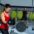 Royalty-Free Stock Photo: Girl dumbbell and man weight lifting bar workout