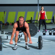 Royalty-Free Stock Photo: Gym with weight lifting bar workout man and woman