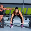 Gym personal trainer man with weight lifting bar woman — Stock Photo #18028179
