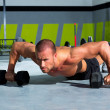 Gym mpush-up strength pushup exercise with dumbbell — Stock Photo #18028253