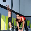 Crossfit gym Kettlebell woman and wall ball man — Stock Photo