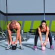 Kettlebells swing crossfit exercise man and woman — Stock Photo