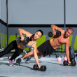 Gym man and woman push-up strength pushup — Stock Photo #18028629