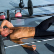 图库照片: Crossfit man tired relaxed after workout