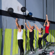 Crossfit workout group with wall balls and rope - Zdjęcie stockowe