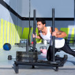 Crossfit sled push man pushing weights workout - Stockfoto