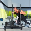 Crossfit sled push man pushing weights workout - Стоковая фотография