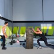Crossfit flip tires men flipping each other — Stock Photo #18029247