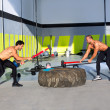 Stock Photo: Crossfit sledge hammer men workout