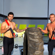 Crossfit sledge hammer men workout - Stock Photo