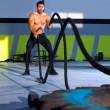 Crossfit battling ropes at gym workout exercise — Stock Photo #18029333