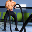 Crossfit battling ropes at gym workout exercise — Stock Photo #18029389