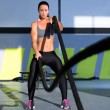 Stock Photo: Crossfit battling ropes at gym workout exercise