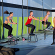 Stock Photo: Crossfit box jump group and kettlebell man