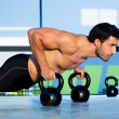 Gym man push-up strength pushup with Kettlebell  — Stock Photo