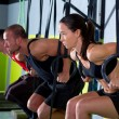 Crossfit dip ring group workout dipping in a row — Stock Photo #18029853