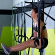 Crossfit dip ring woman workout at gym dipping - Stock Photo