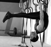 Crossfit dip ring man workout at gym — Stock Photo