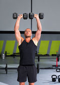 Gym man with dumbbells exercise crossfit — Photo