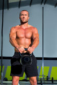 Crossfit Kettlebells swing exercise man workout — Stock Photo