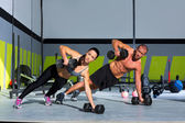 Gym man and woman push-up strength pushup — Stok fotoğraf