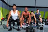 Gym group with weight lifting bar crossfit workout — Foto Stock