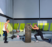 Crossfit flip tires men flipping each other — 图库照片