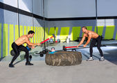 Crossfit sledge hammer men workout — Stock Photo