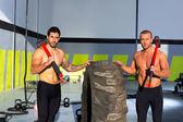 Crossfit sledge hammer men workout — Stock Photo
