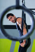 Crossfit dip ring man workout at gym — Stock Photo