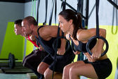 Crossfit dip ring group workout dipping in a row — Stock Photo