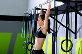 Crossfit toes to bar woman pull-ups 2 bars workout — Stock Photo