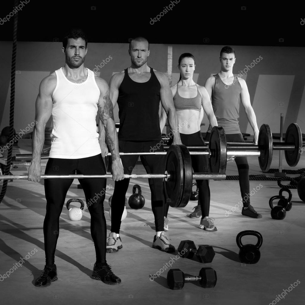 Gym group with weight lifting bar crossfit workout — Stock ...