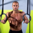 Crossfit dip ring man relaxed after workout at gym — Stock Photo