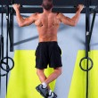 Crossfit toes to bar man pull-ups 2 bars workout - Stock Photo