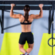 Stock Photo: Crossfit toes to bar wompull-ups 2 bars workout